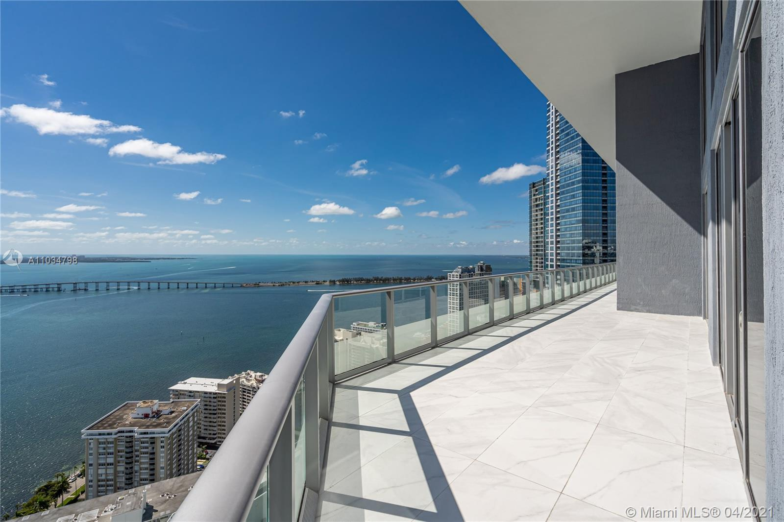 Breathtaking water views from this brand new 2 Story Penthouse. 20 feet high ceilings, Italian desig