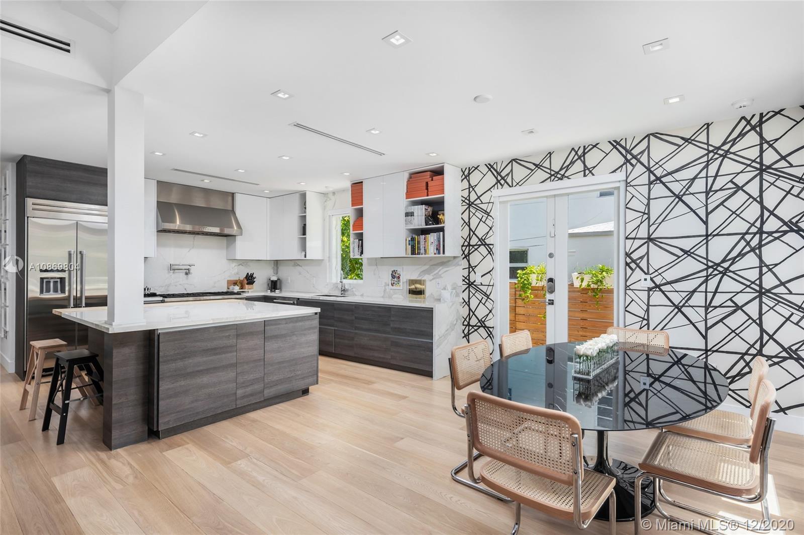 Newly built Miami Beach home w/3 beds, a den, & 2.5 baths. Custom designed residence offers an open