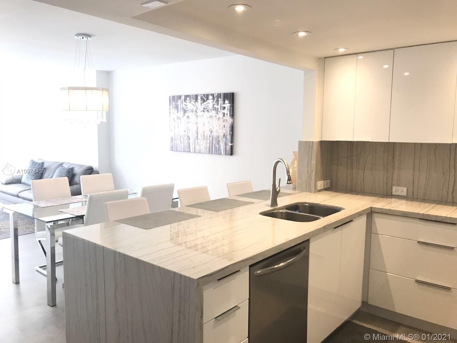 """Impeccably remodeled 1BR converted into two-bedroom, two full bathrooms condo. 24""""x48"""" Spanish porce"""