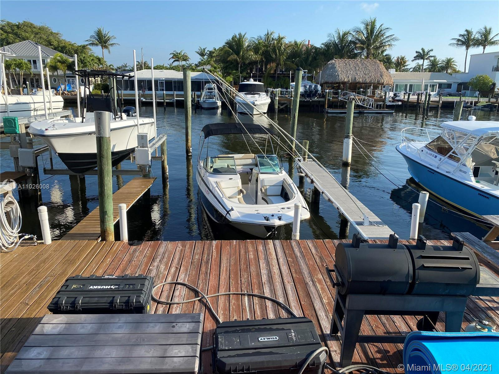 RARELY AVAILABLE SINGLE FAMILY HOME IN AN EXCLUSIVE WATERFRONT COMMUNITY WITH PRIVATE DOUBLE DOCK! T