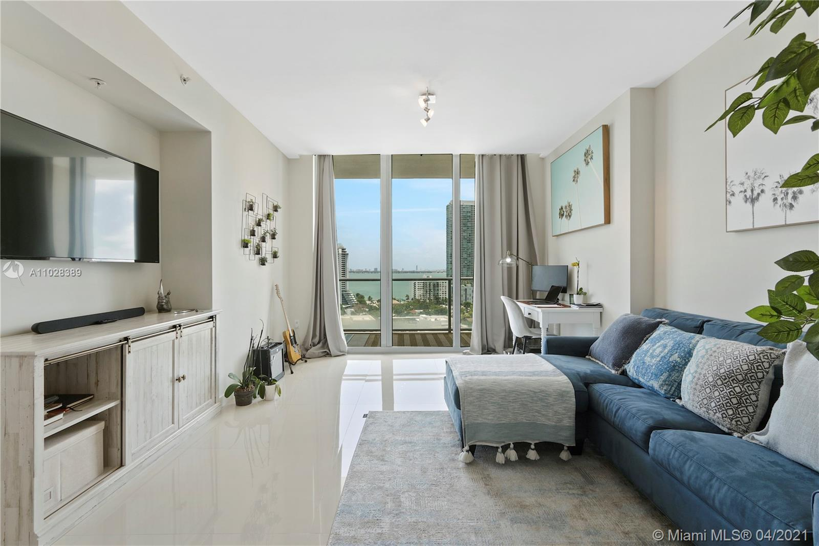 Beautiful Bay Front unit with a stunning view. Floor to ceiling windows and large glass balcony. U