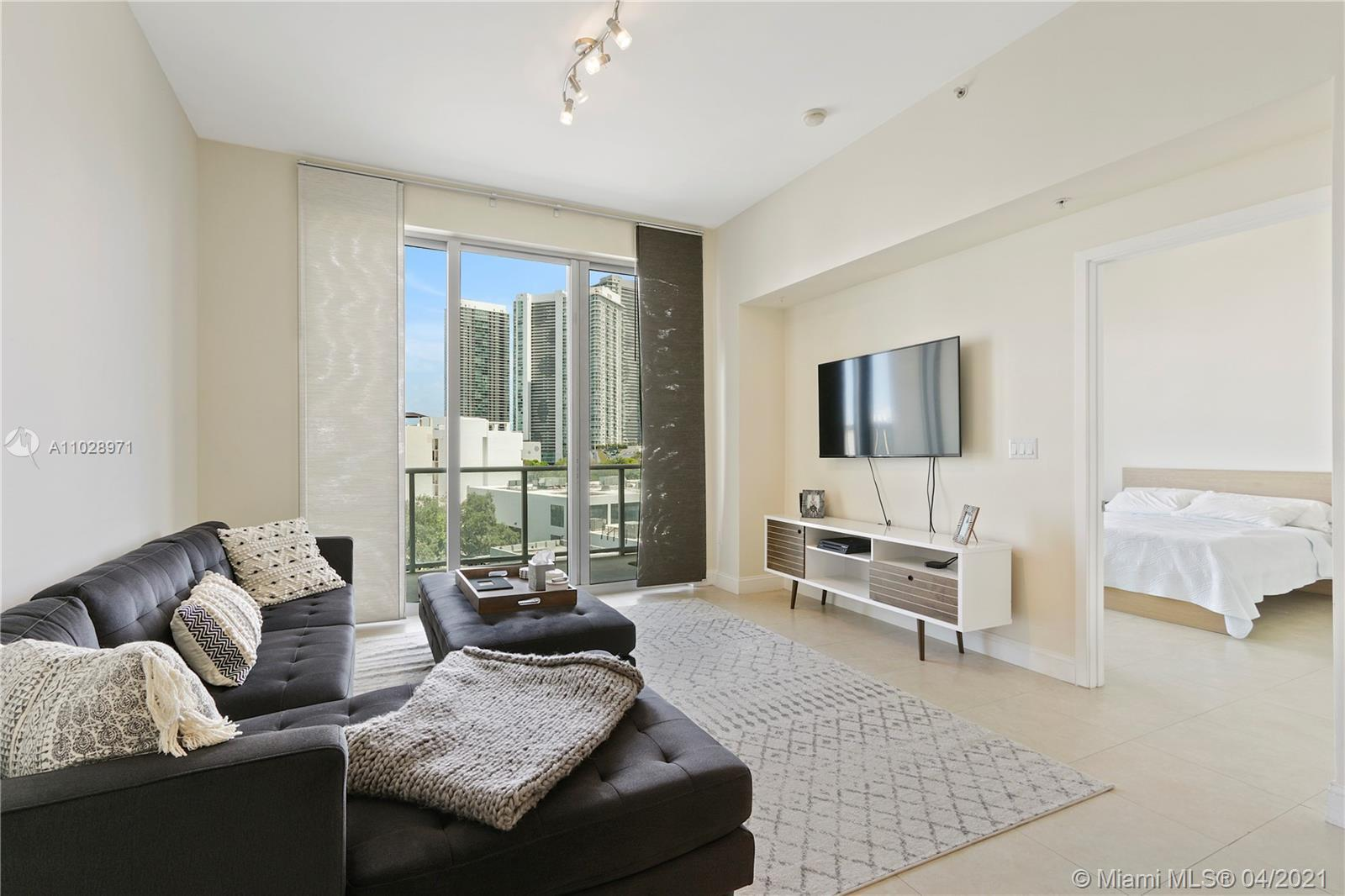 Beautiful Bayfront unit. Floor to ceiling windows with a large glass balcony. Upscale building loc