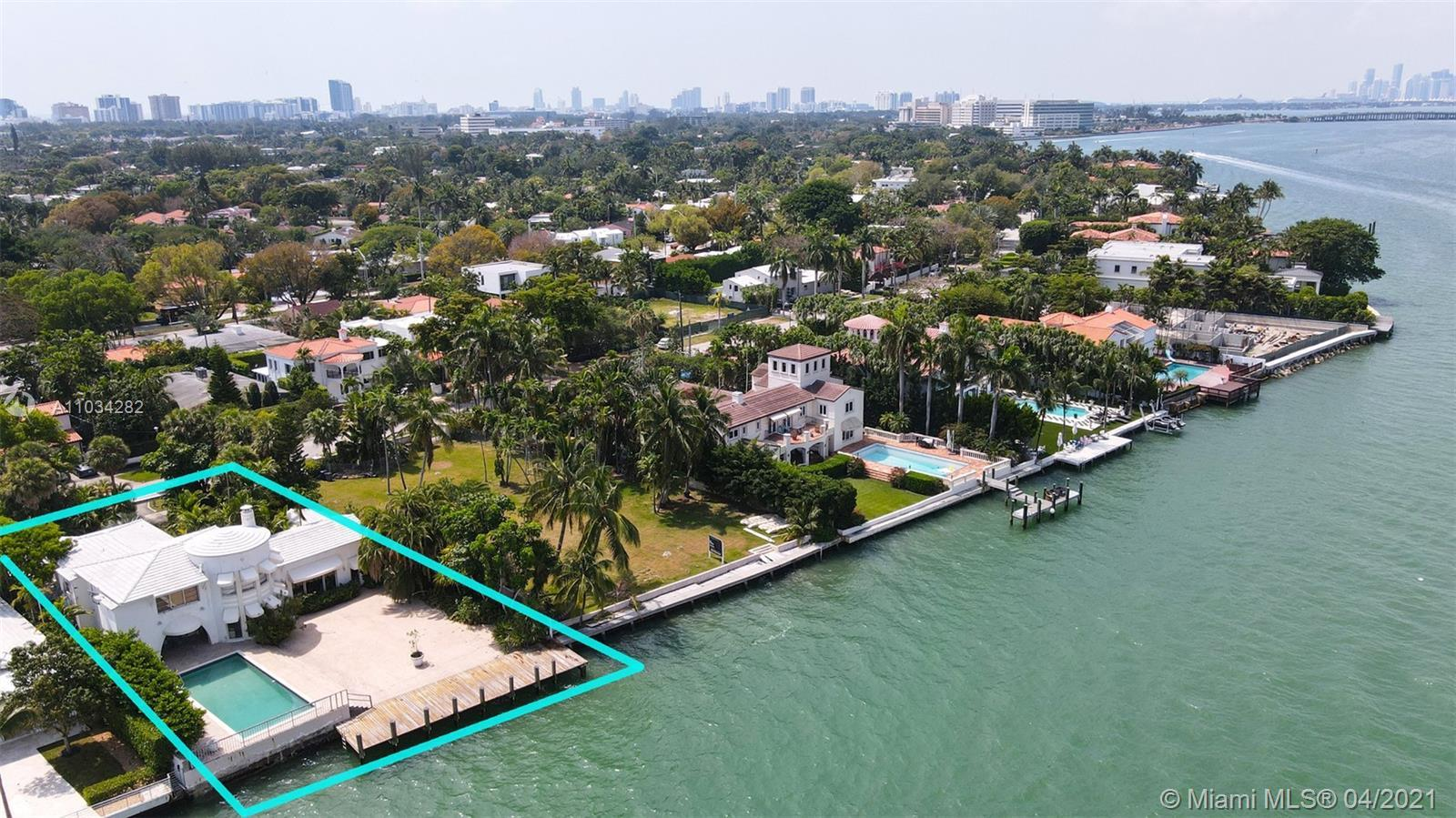 This premier waterfront estate features an unobstructed wide Biscayne bay view with one of the large