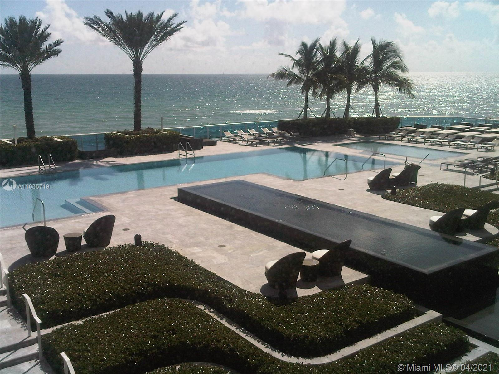 CABANA INCLUDED! with this furnished Beachfront unit year 2010. 4 story glass tower overlooking the
