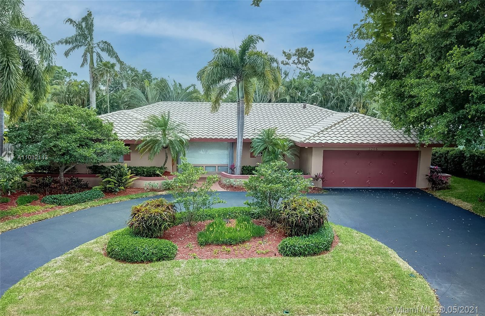 Own this elegant rare single-level 4BR home on the most coveted street in Coral Ridge Country Club.