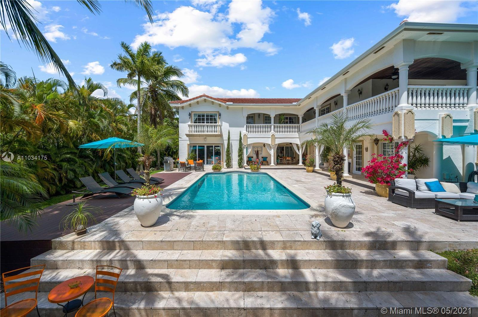 TWO STORY WATERFRONT RESIDENCE IN DESIRABLE GOLDEN ISLES WITH 100 FT. OF DEEP WATER FRONTAGE. BOATER