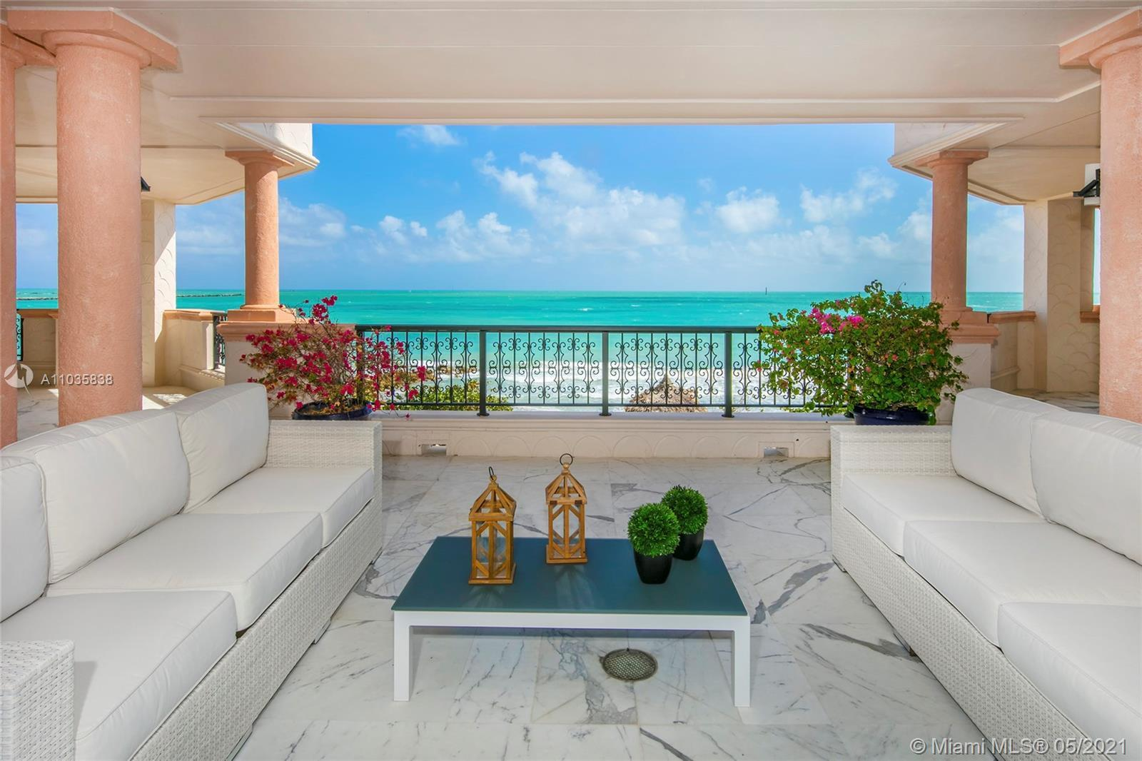 This exclusive oceanfront center stack unit on Fisher Island has a unique privileged location as it