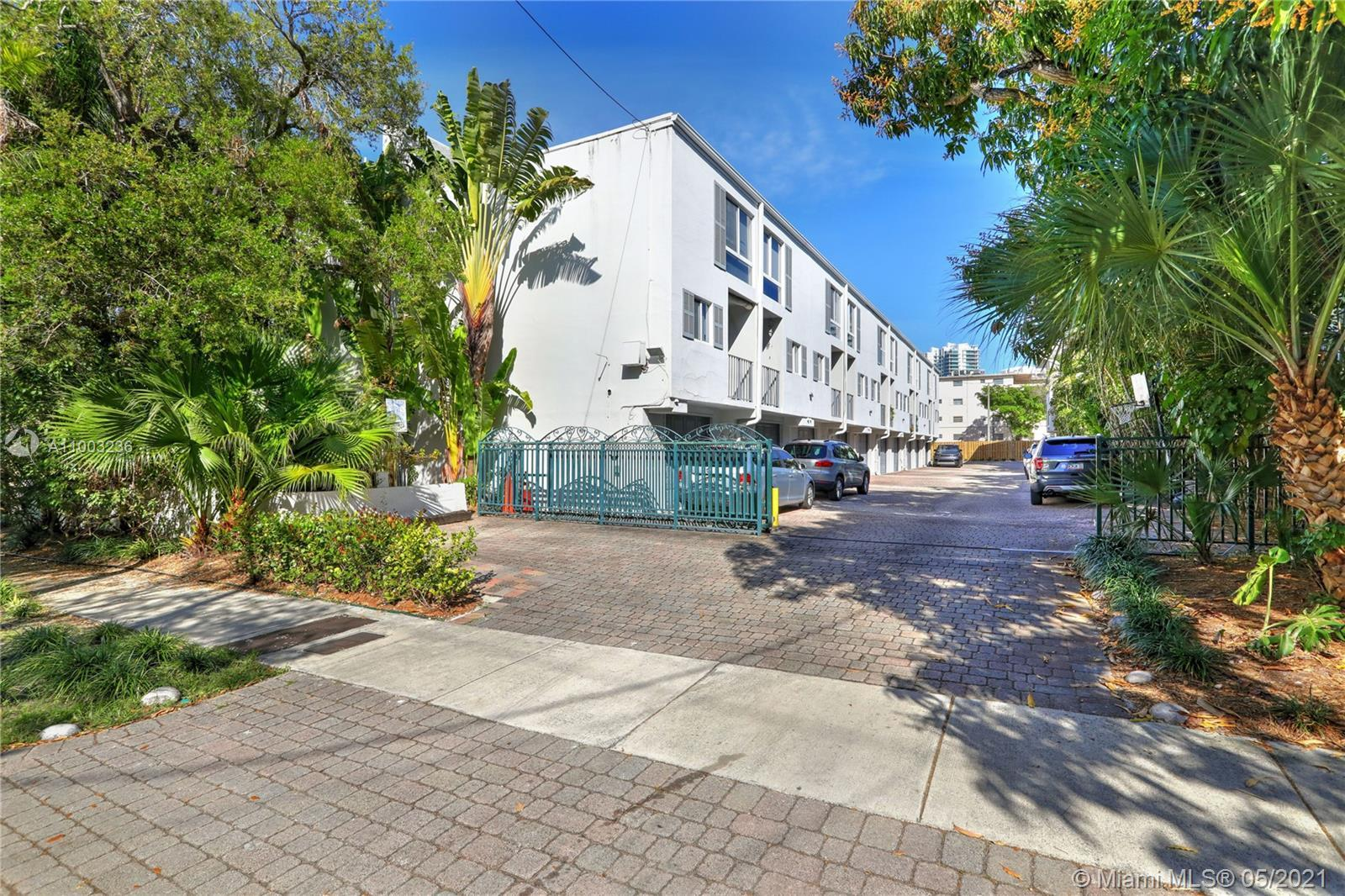 Walk, bike, or scooter to everything from this Coconut Grove townhome! Peppertree Village is a lushl