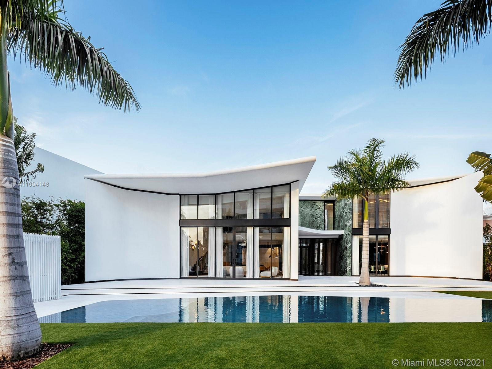 Sited in one of Miami Beach's exclusive enclaves, this private estate on Lakeview Drive features 111