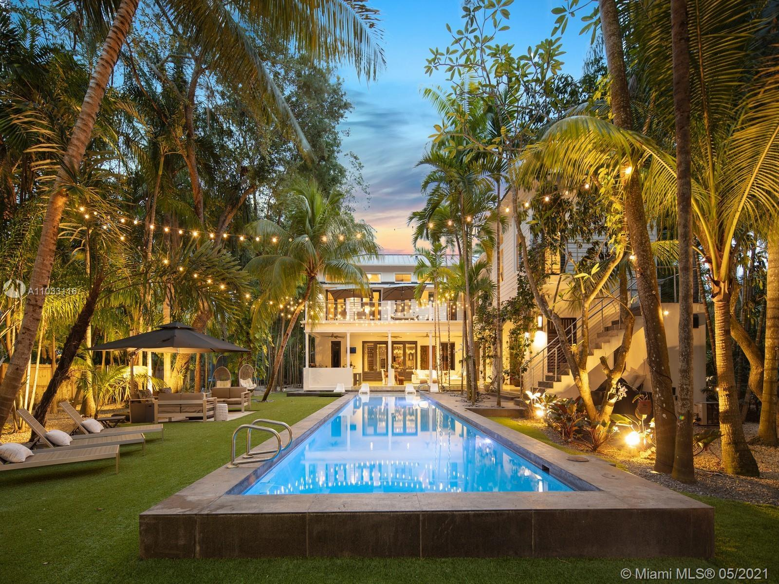 This enchanting tropical paradise is a true hidden gem, located in N Pinecrest & enveloped by exotic