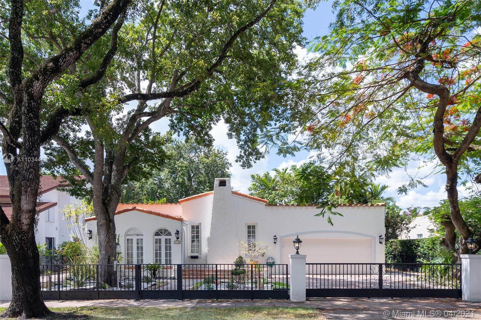 Gated 1920's Old Spanish villa situated on a historic tree-lined street in Coral Gables. Completely