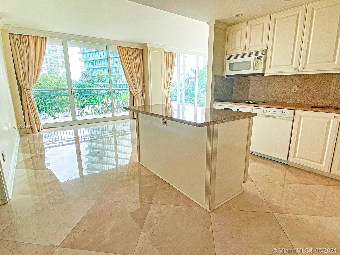 Indulge in luxury living at the Ritz-Carlton Residences in Coconut Grove. 2 bed, 2.5 bath unit with