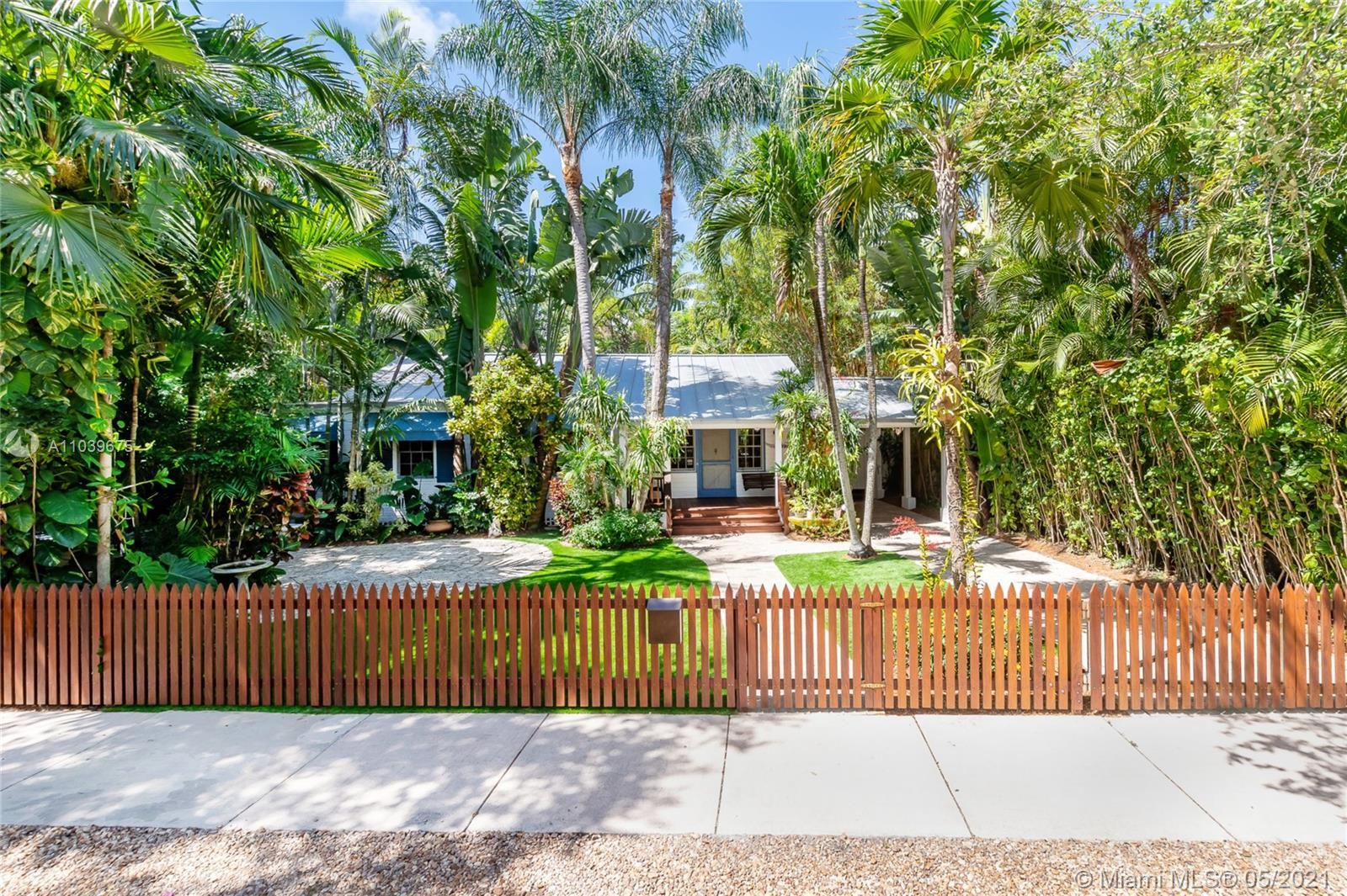 Enter through the Brazilian Ipe picket fence into this Coconut Grove botanical wonder. Exceptional c