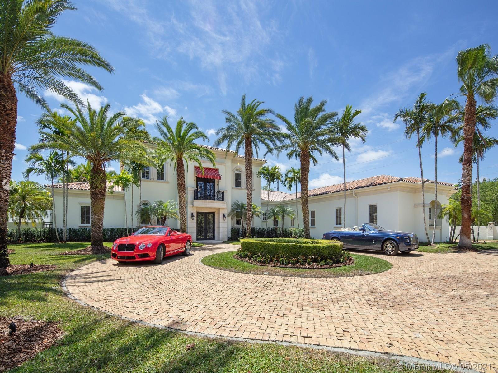 Impressive one acre + custom estate located in Prime North Pinecrest. This magnificent 11,046 sf hom