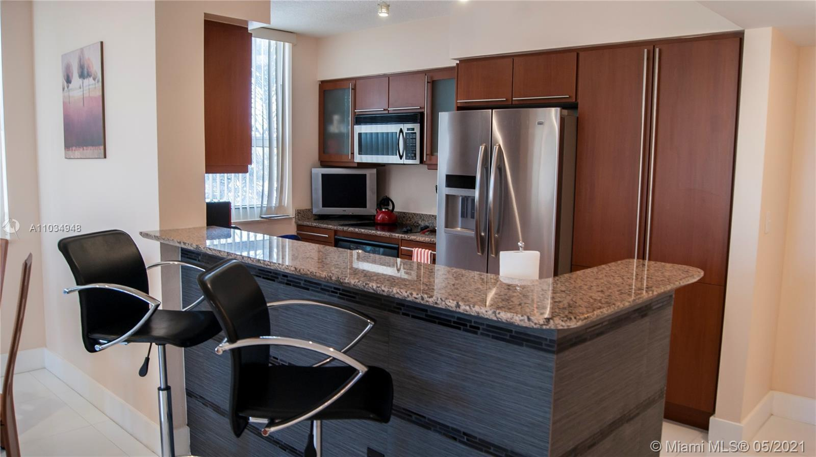 Turn Key fully furnished corner apartment with wrap around balcony in a newer construction boutique