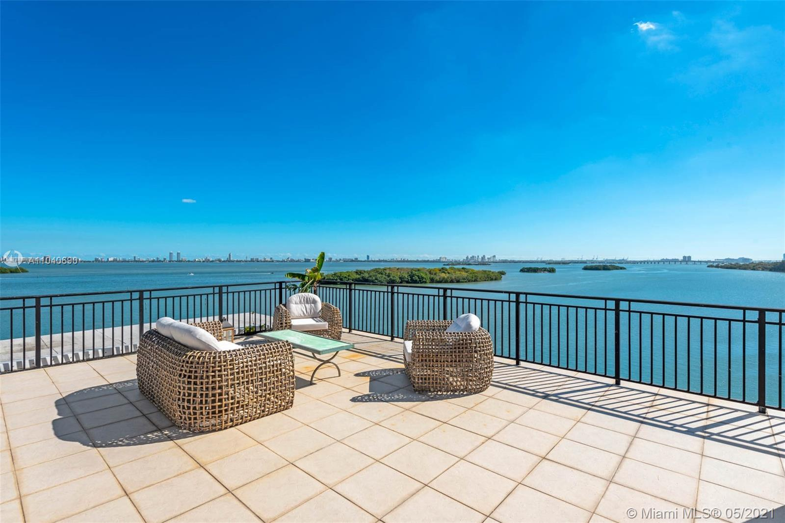 Private, unobstructed bay views for miles are yours in this exquisite and unique 3,500 square foot p