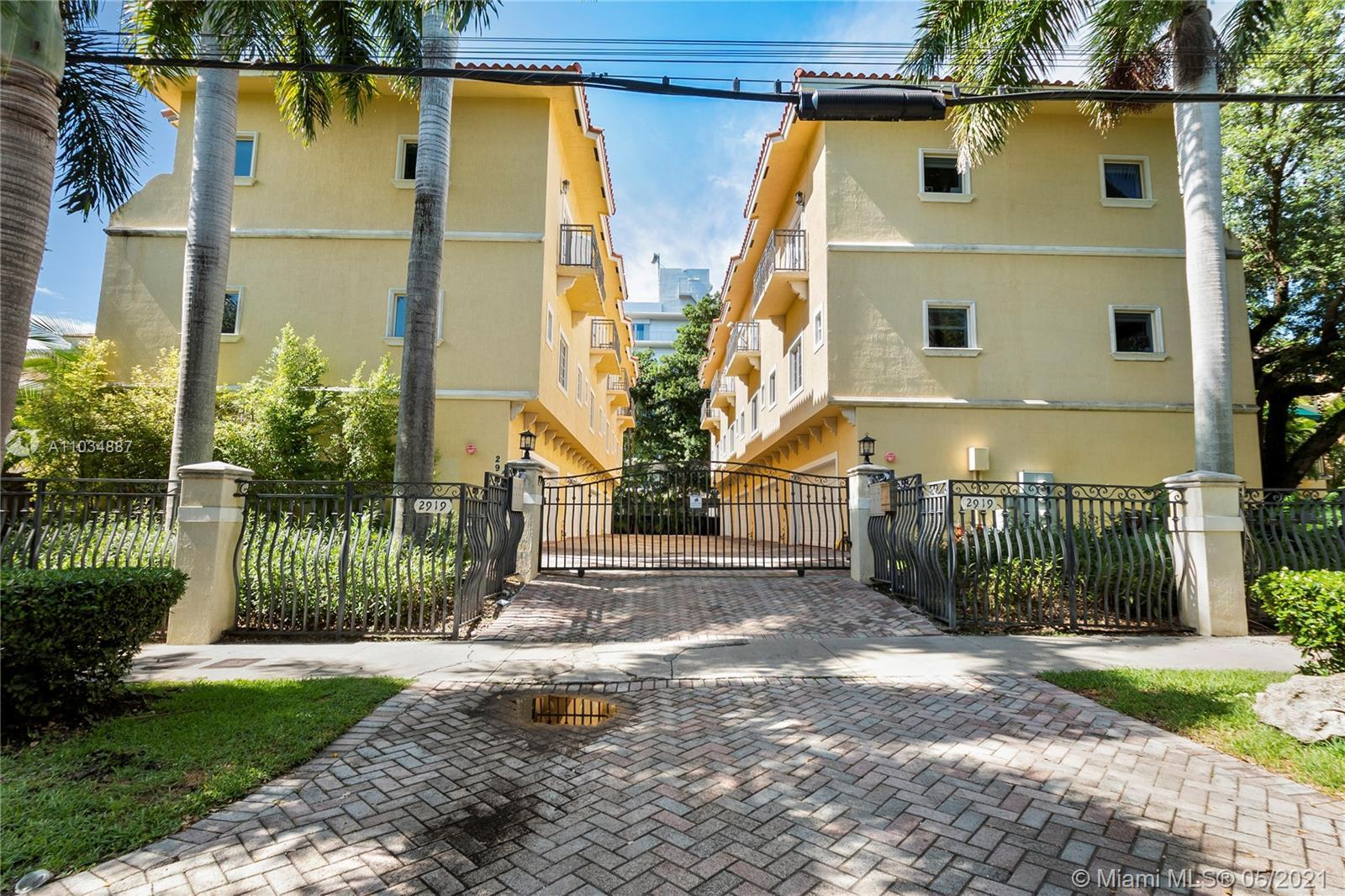 This is a gorgeous, tri-level townhome, just a short walk from Coconut Grove village with incredible
