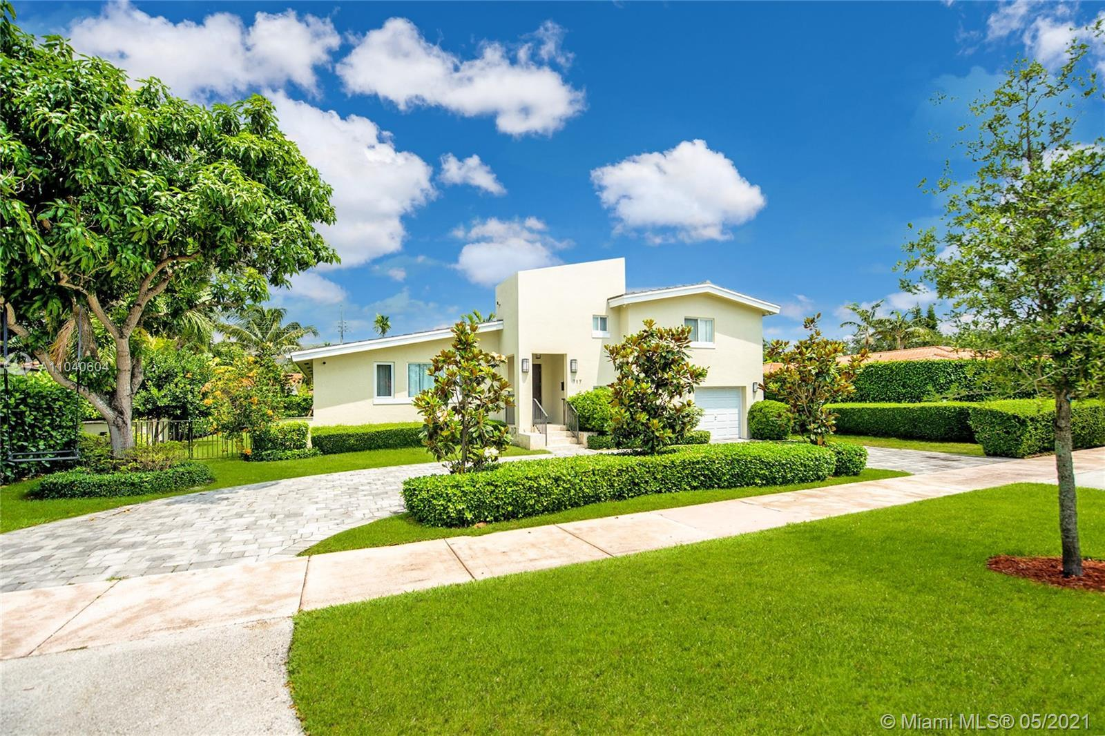 Lovely home on a quiet, tree-lined street close to UM & world-class Coral Gables shopping & dining.