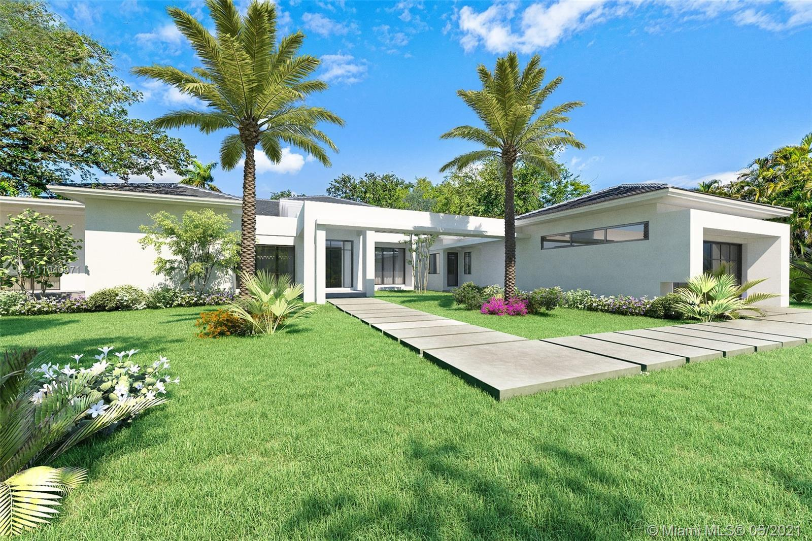 This spectacular modern estate built by Crawford Development offers a grand North Pinecrest location