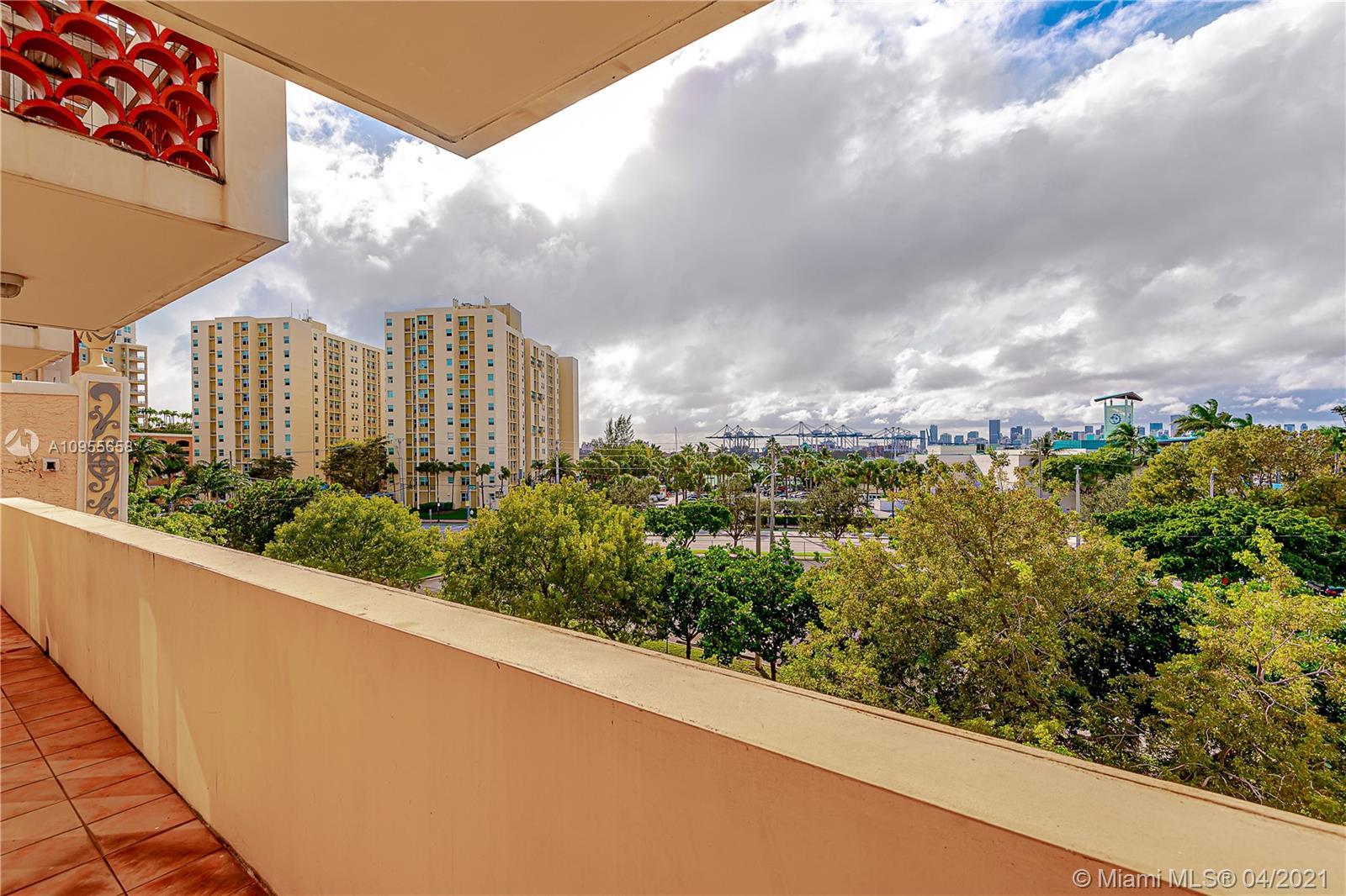 Spacious and sunny front corner 2/2 unit with views all the way to the bay. Sought after South of Fi