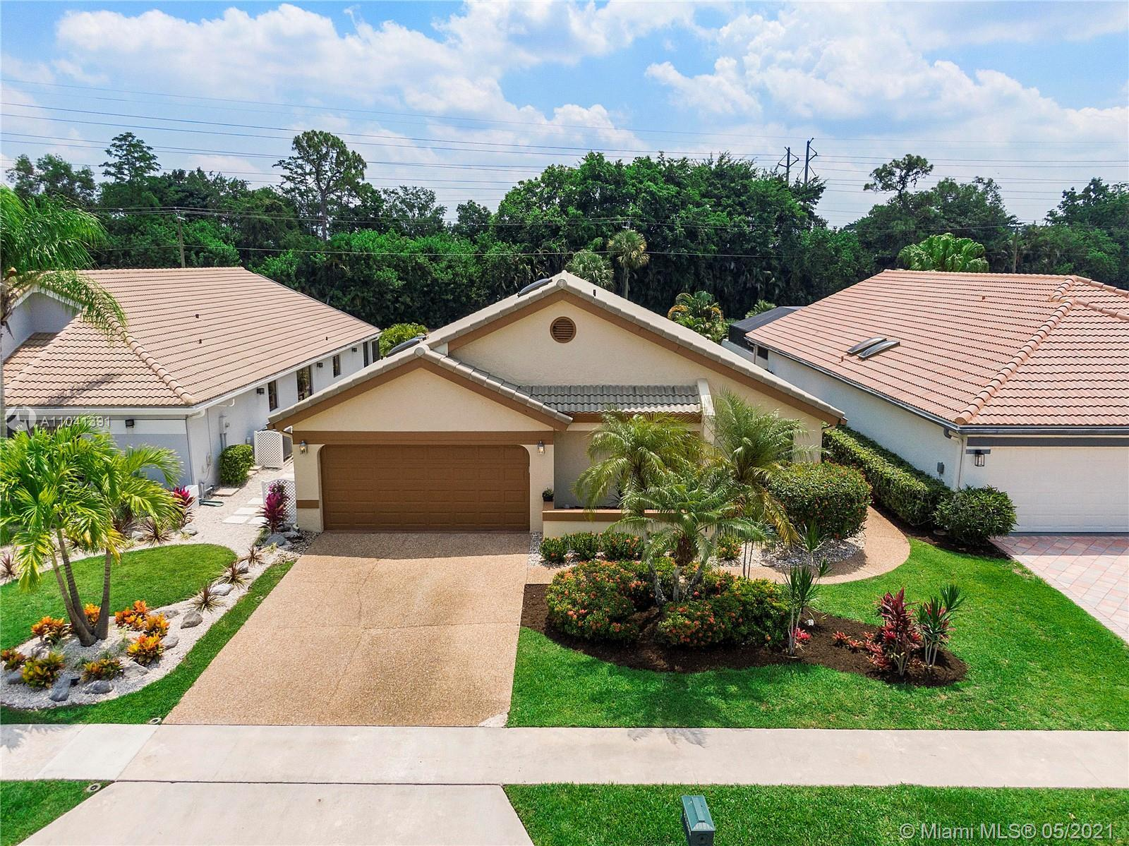 Outstanding single-family home for sale at Boca Woods Country Club, a desirable gated golf community