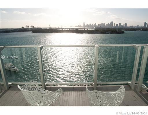 STUNNING 1 BEDROOM CONDO WITH BALCONY AND DIRECT BAY VIEW OVER LOOKING THE SKYLINE, THE BAY AND THE