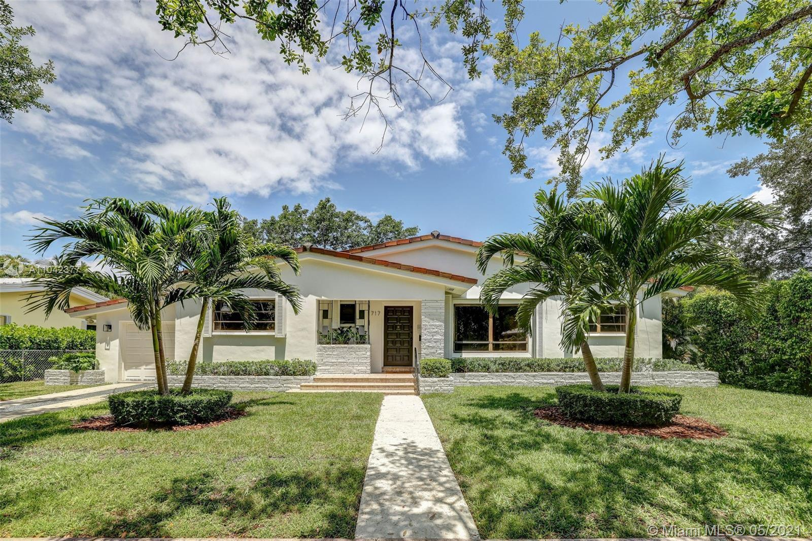 A perfect family home on a quiet tree-lined street in Coral Gables. 4 large bedrooms, 3 full baths,