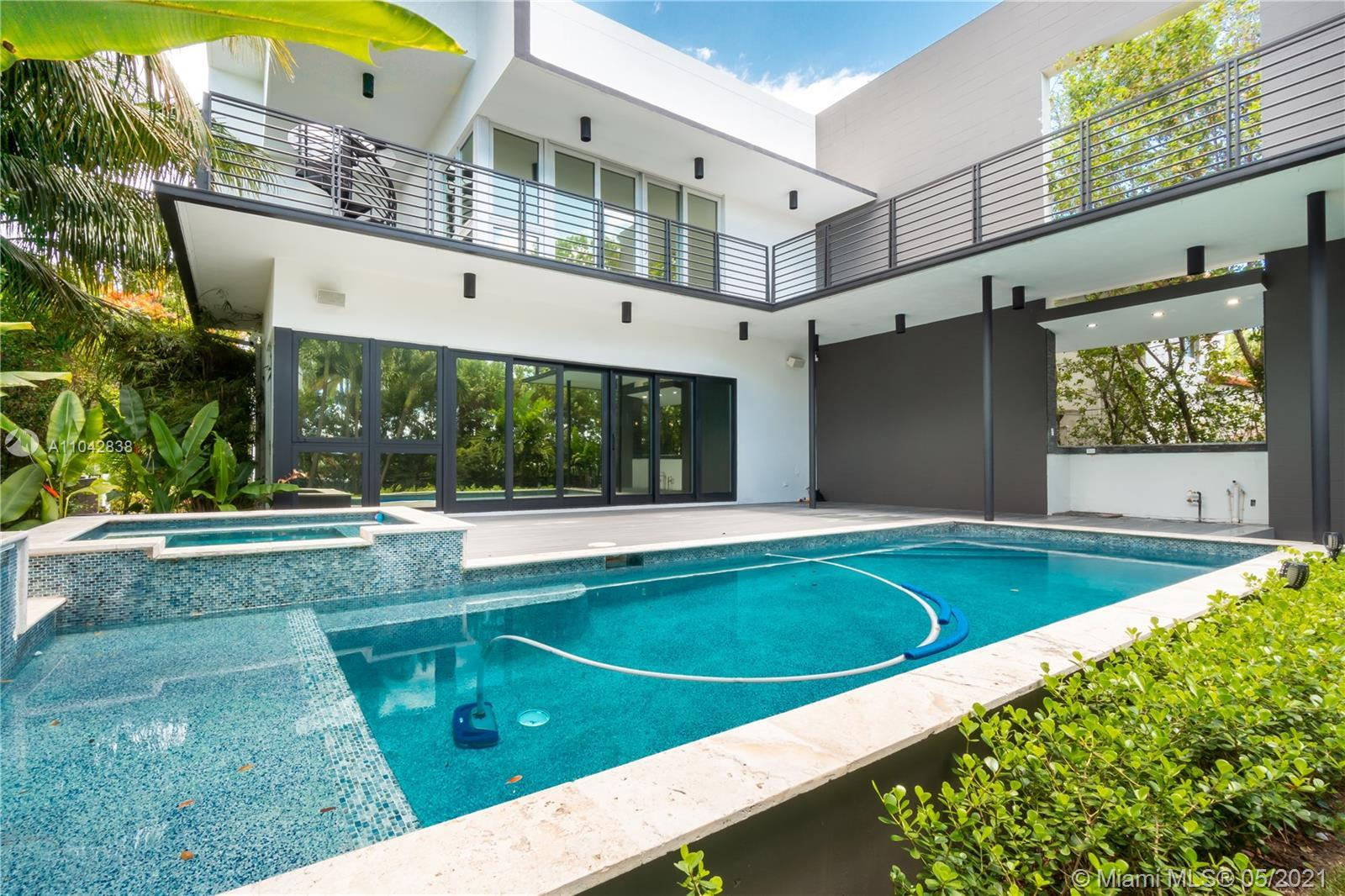 Hot and new on the market! 5bd/5ba stunning modern home features a prestigious location steps away f
