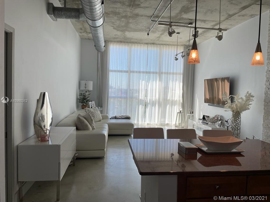 Amazing NY-loft-style condo showcases ductwork, polished concrete floors and soaring 11ft concrete c