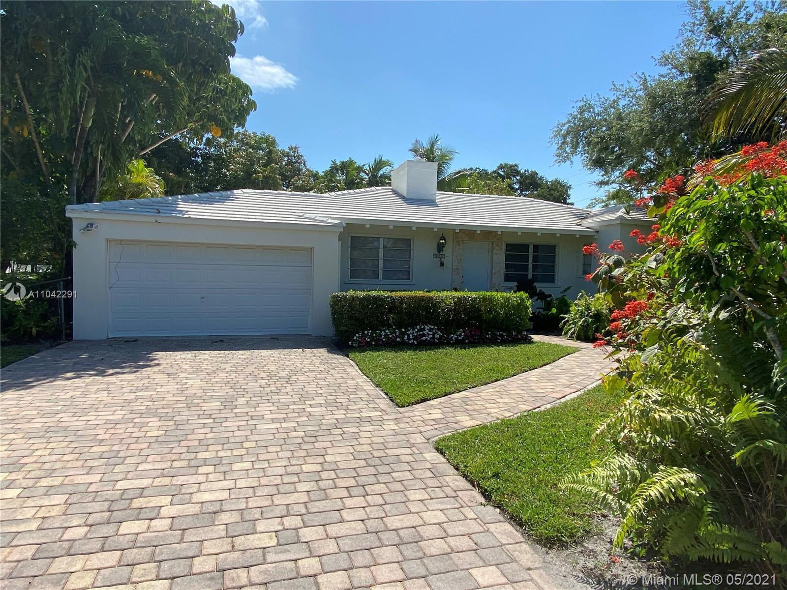 Beautiful and spacious 2 Bdrm 1.5 bath home in Miami Shores on a 11,760sqft corner lot. The home fea