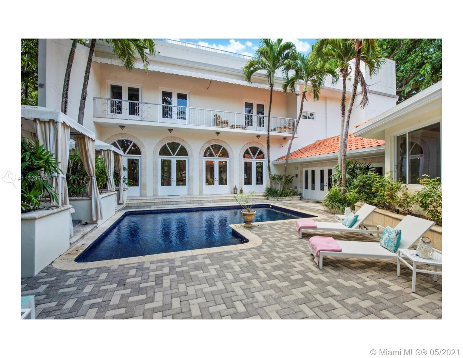 Elegant, walled estate perched high on coral ridge with lush grounds.Tucked away behind gates for th