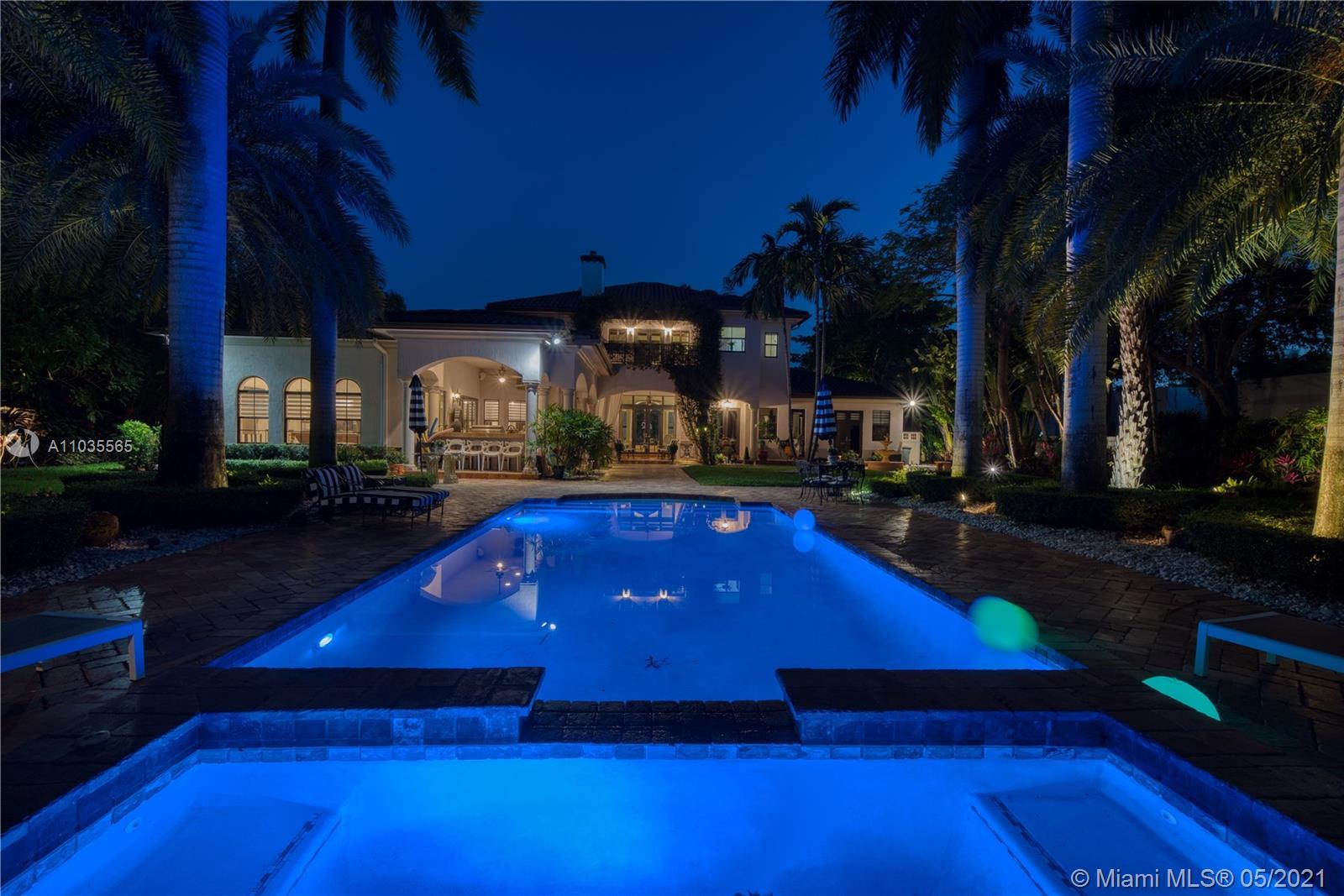 This elegant and sophisticated European Transitional masterpiece sits on a rare deep acre lot. This
