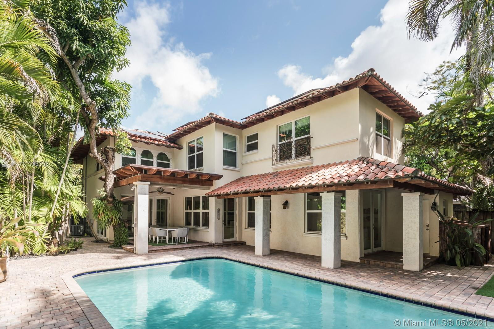 Stylish Mediterranean 4,014 Sq. Ft. Coconut Grove home with 4 bedrooms, 3.5 baths. Loft-style floor