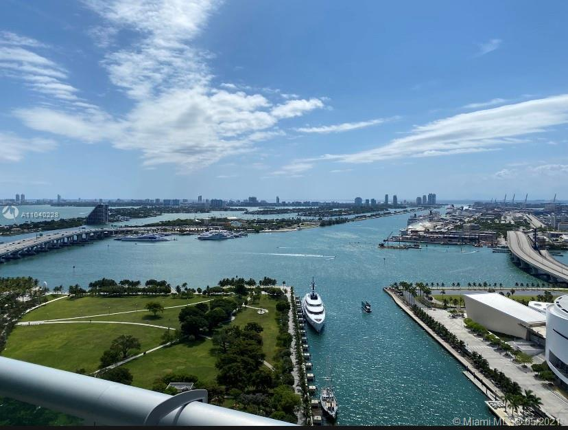 SPECTACULAR PANORAMIC EAST AND WEST VIEWS! ENJOY DIRECT VIEWS OF BISCAYNE BAY, THE ATLANTIC OCEAN, M