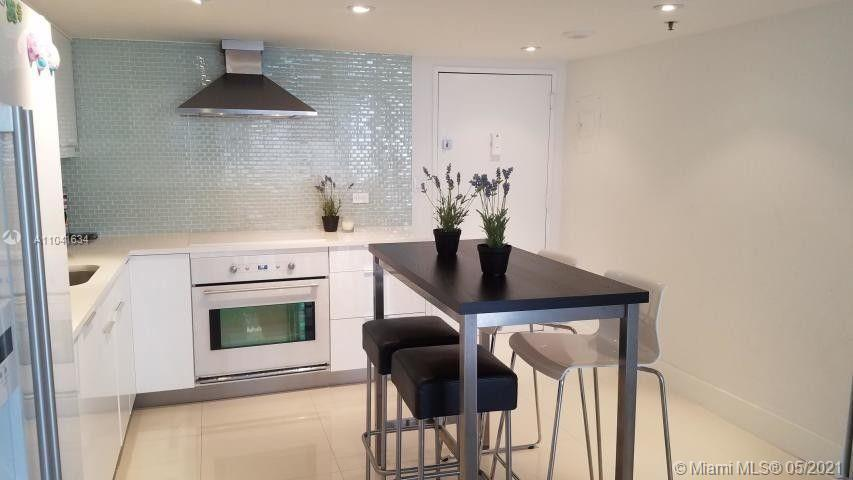 This condo is sure to impress. Upgraded open kitchen with granite, decorative backsplash, , Washer/D