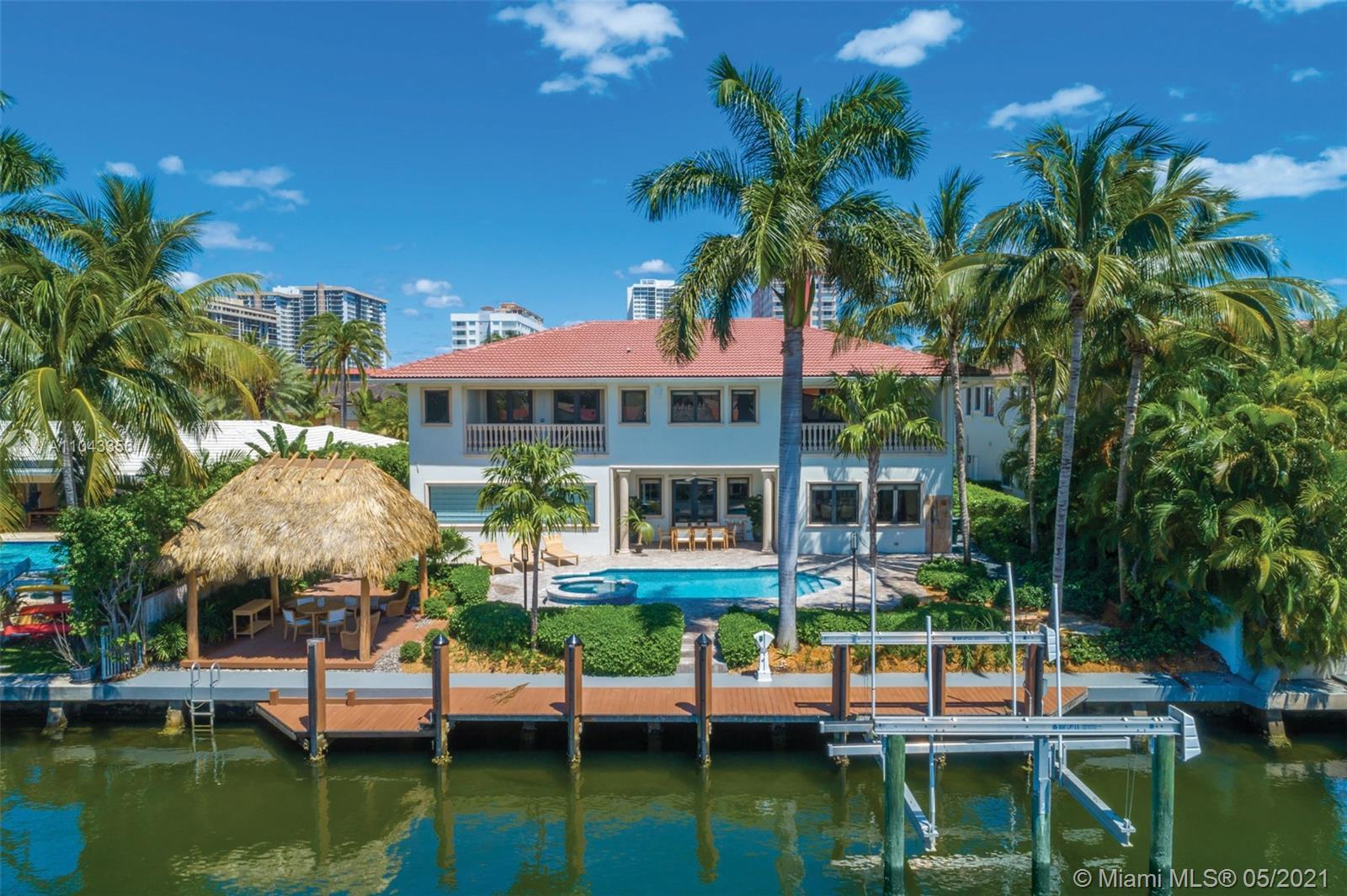 PREMIER WATERFRONT ESTATE IN CENTRALLY LOCATED, GUARD-GATED GOLDEN ISLES COMMUNITY. BOATERS PARADISE