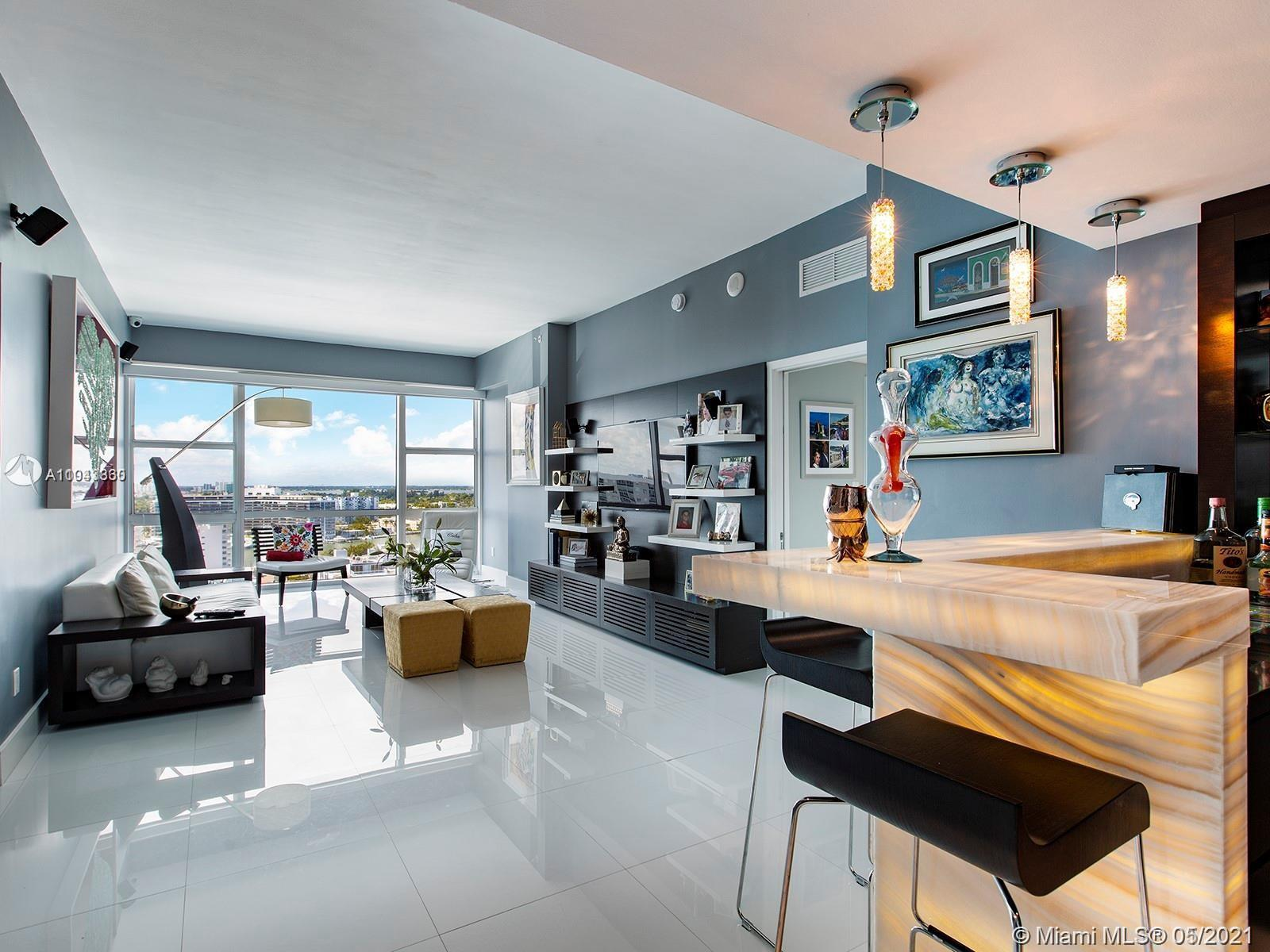 Penthouse living at The Carillon with panoramic bay and ocean views from every room! Completely re-a