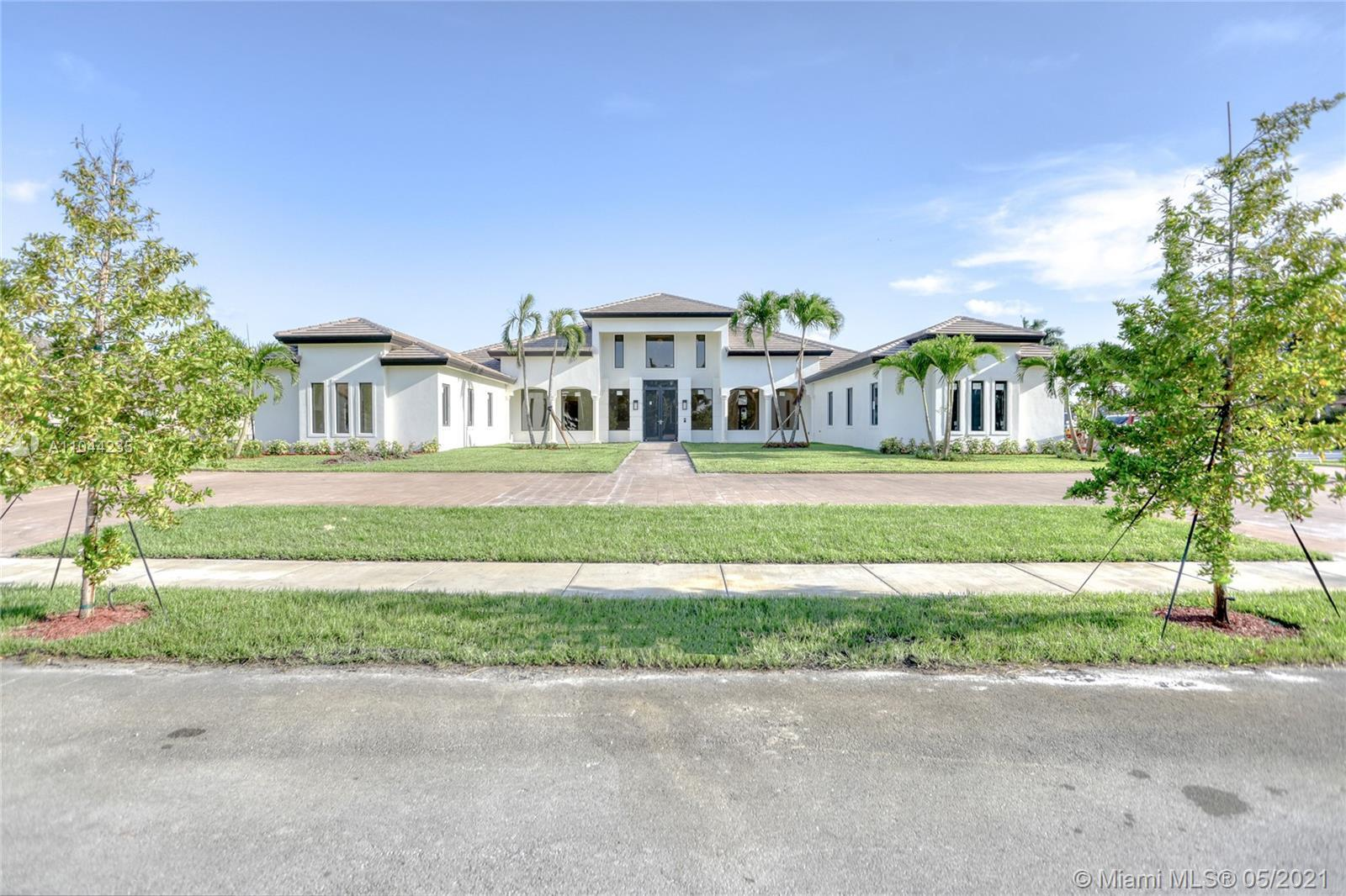 Custom home in a private gated community that features Golf and Country Club amenities. With 5 bedro