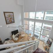 NY Loft Style with skyline views. The unit has soaring ceilings, 1/2 bath downstairs, W/D in unit. P