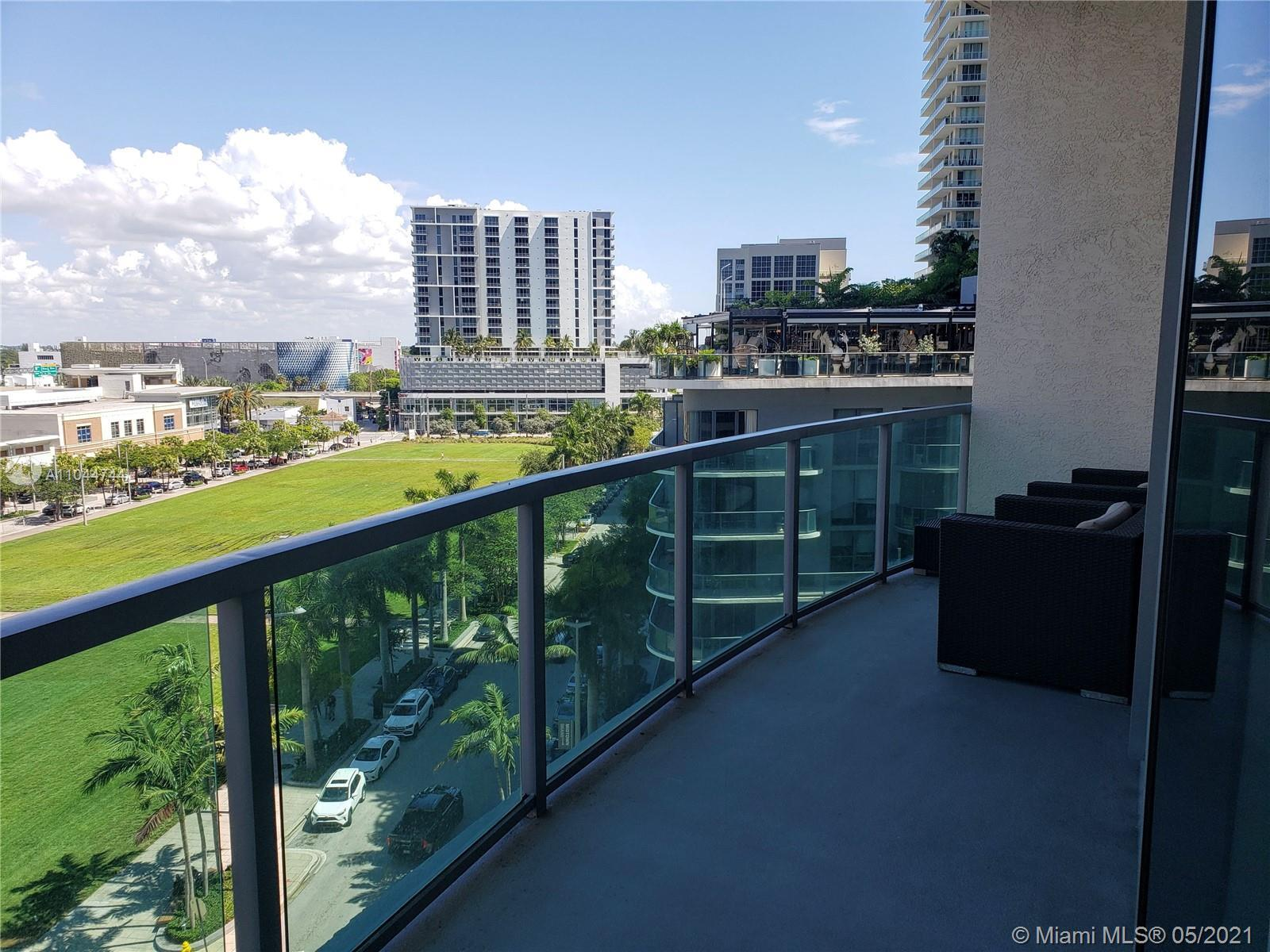 Enjoy great city and sunset views from this beautiful 2 bed/ 2 bath corner unit at 4 midtown. The re