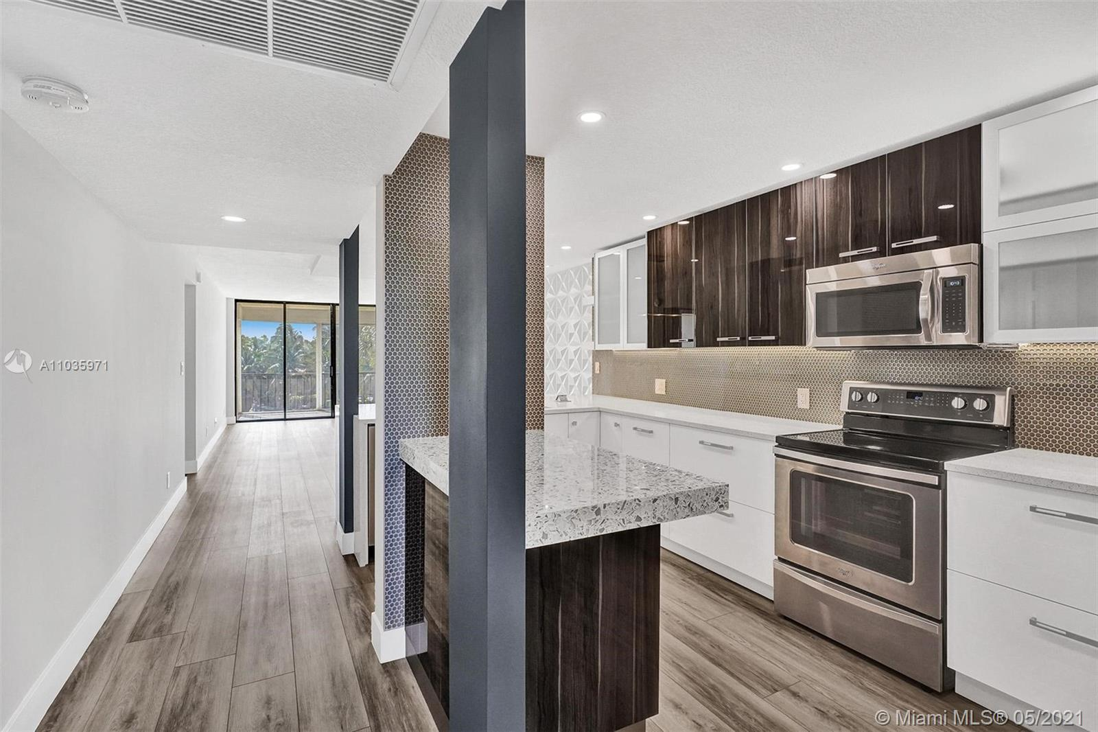 Stunning!! One of a kind modern gem... Sophisticated and modern living in the highly desired Boca Ba