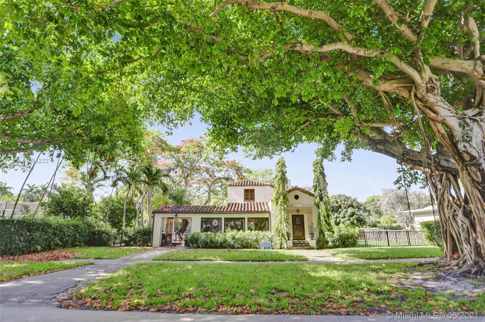 Stunning Mediterranean Revival, Historic Landmark home is located on a coveted street across from Co