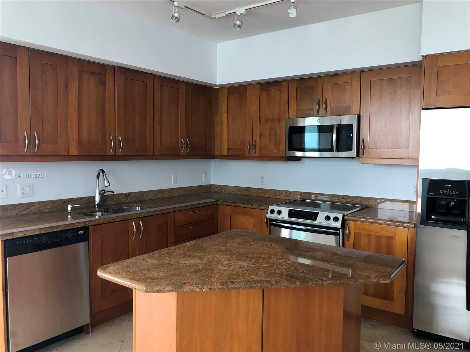 BEAUTIFUL 3 BEDROOM 2 BATH UNIT WITH SPECTACULAR VIEWS OF DIPLOMAT GOLF COURSE. MARBLE AND LAMINATED