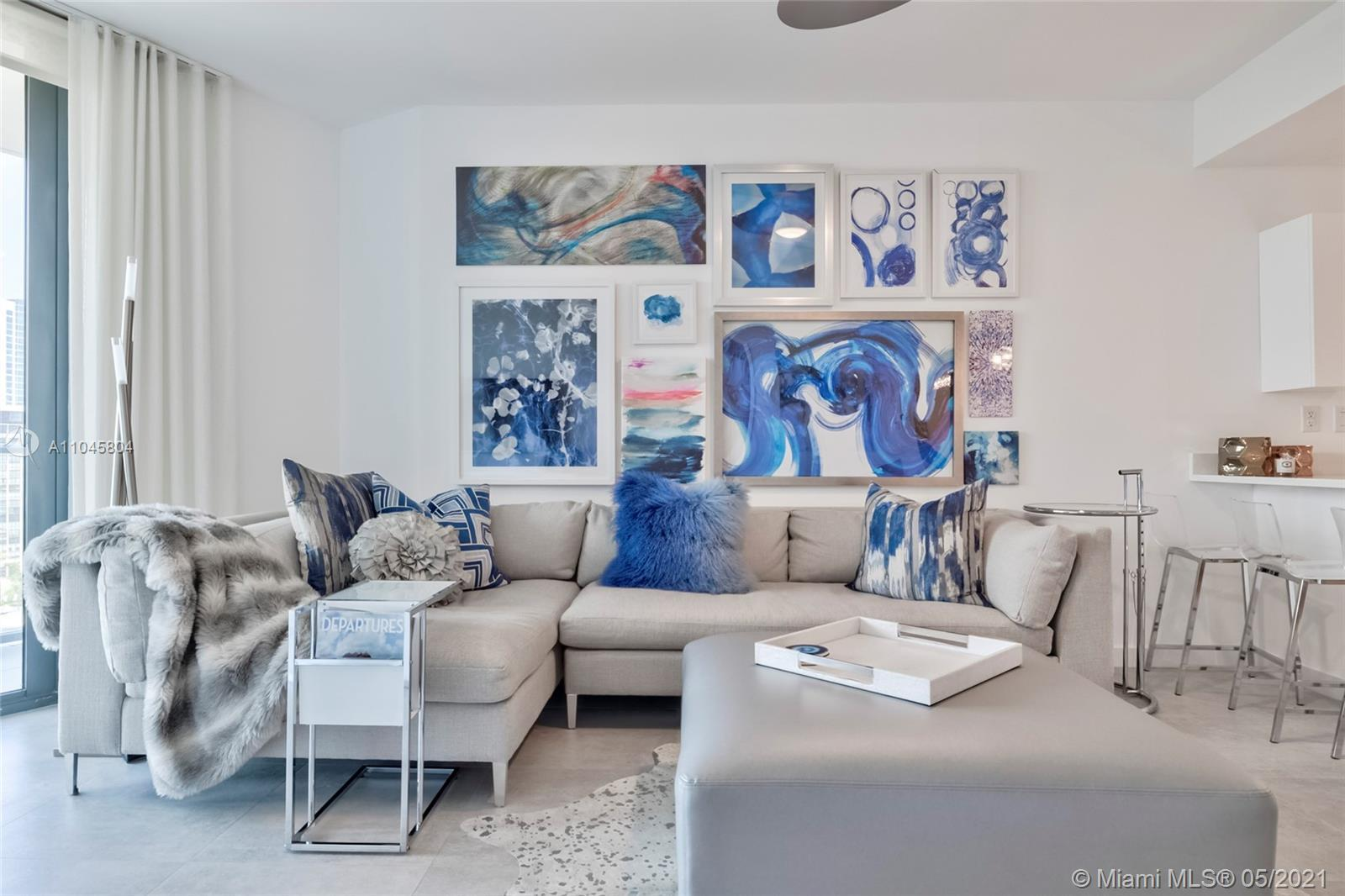 NYC meets Miami with this professionally designed corner unit offering endless views of the bay, Des