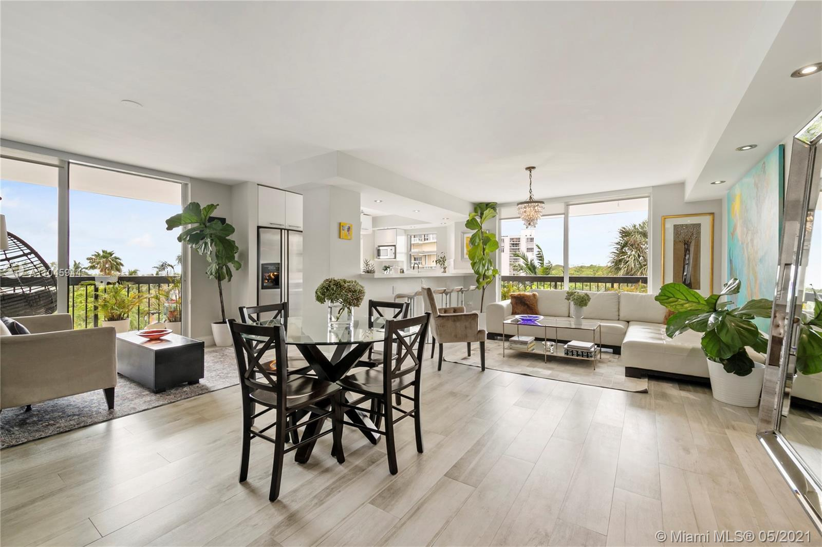 Stunning completely large 2 bed /2 bath condo plus den with beautiful natural light in the heart of
