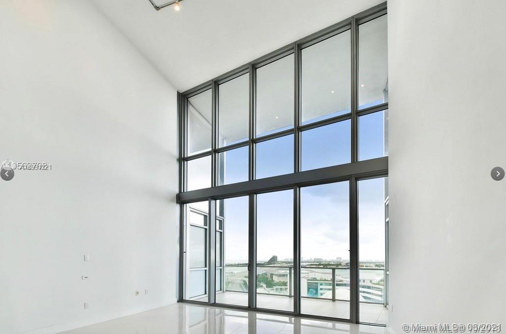Beautiful view of the city from a 22' ceiling, porcelain tile and wood floors, with an modern open k