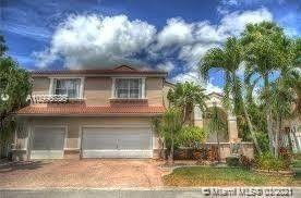 This oversized corner-lot features a split plan of 6 bedrooms and 3 bathrooms, beautiful pool home w