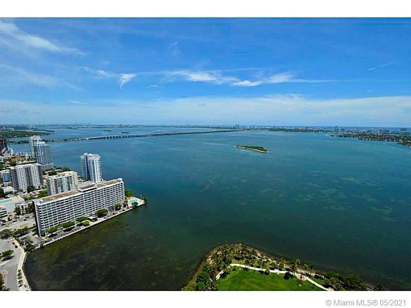 Fabulous penthouse in the heart of Edgewater w/ sweeping water & city views. Sunrise to sunset views
