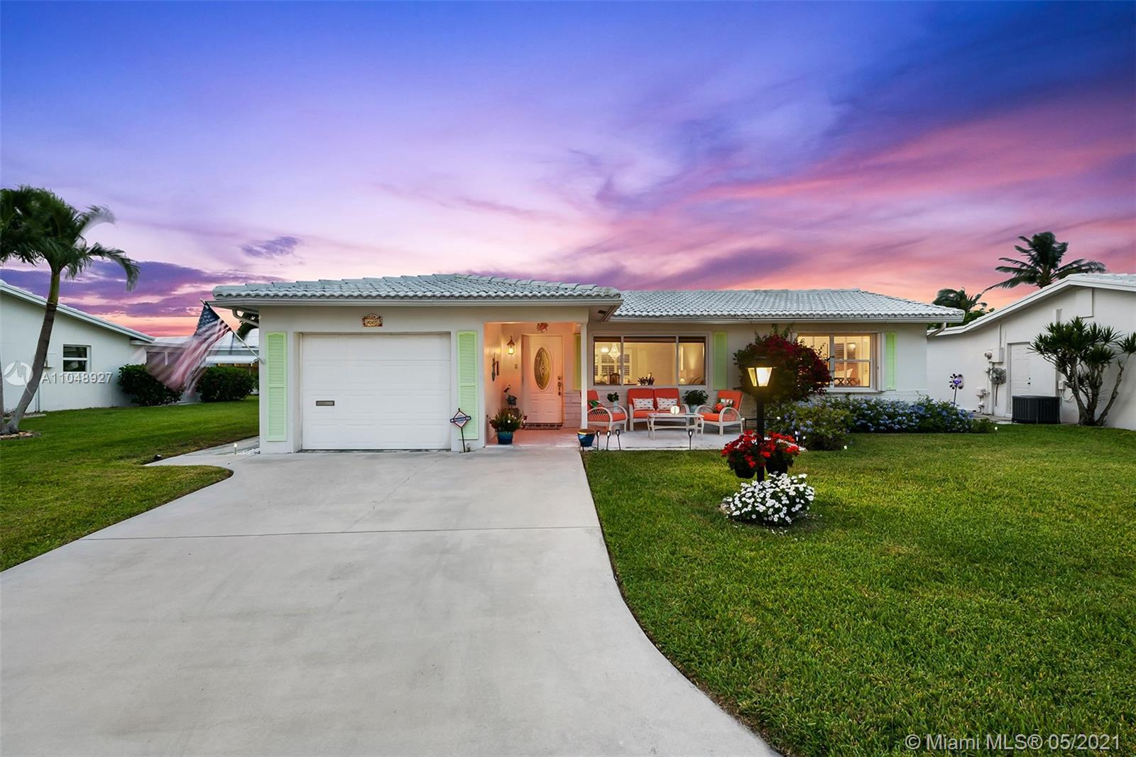Welcome Home to this gorgeous 3 bedroom, 2 bathroom residence located on an oversized lot with beaut