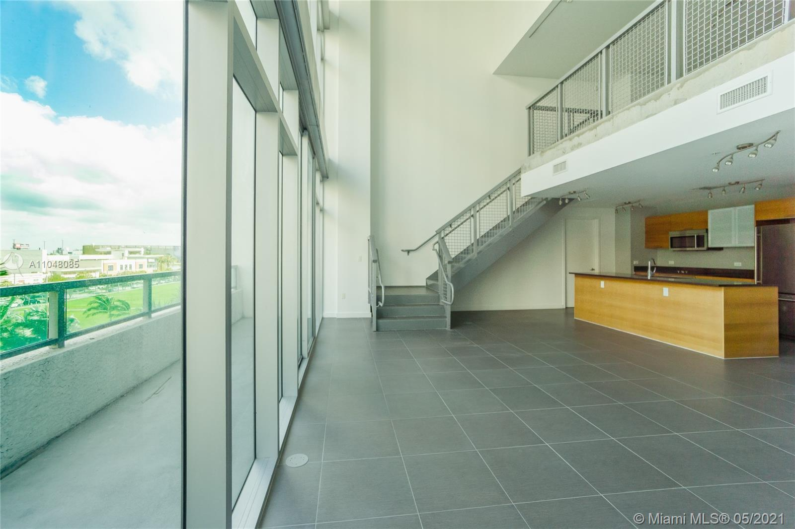 Spectacular 2-Story in the heart of Midtown. Over 1,500 SqFt of living area, the 1 bed + den urban s